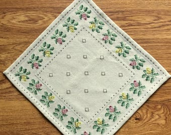 Well done table cloth, handmade embroidered with flowers in cross stitch on beige linen from Sweden.