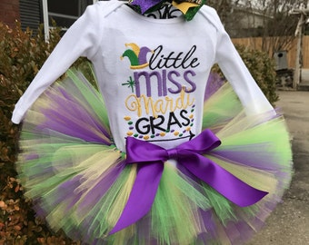 Reserved listing for Mardi Gras Tutu, a matching first birthday long sleeve onesie and bow