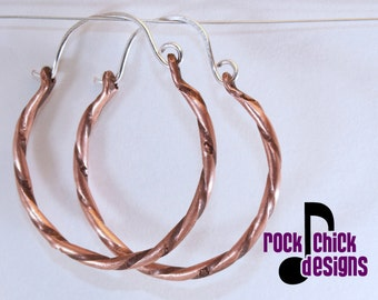 Twisted copper hoop earrings, dainty, medium 1 inch diameter, with tiny flowers, silver ear wires -- salvaged copper wire