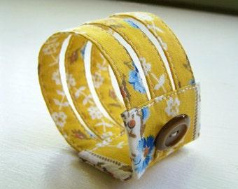 Triple strand cuff bracelet in vintage golden floral