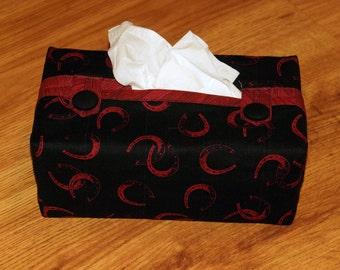 Fitted Tissue Box Cover fits Kleenex brand boxes.  Black cotton fabric with red horseshoes. Made by Barb Lynn