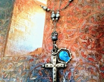 Antique silver cross and blue enamel Madonna charm necklace .
