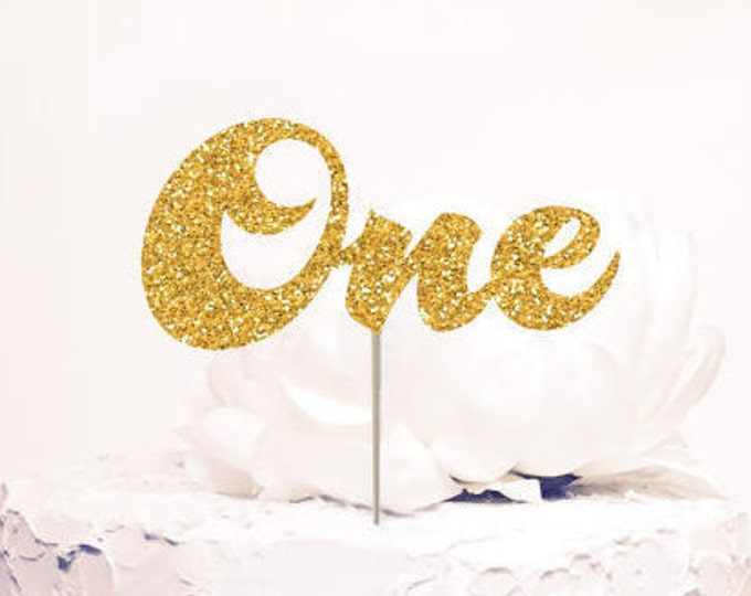 One Cake Topper, First birthday. Chic birthday decor. Gold Glitter. Cursive Script letters.