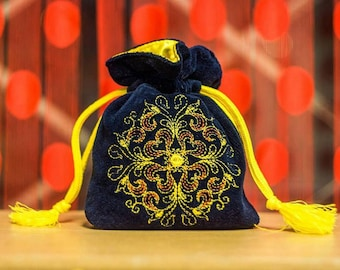 Sacral embroidered mini bags