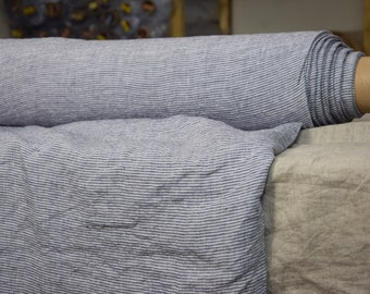 Linen fabric. Pure 100% linen 160gsm. Striped, horizontal dark blue and white 2mm pinstripes. Medium-light weight, washed-softened.