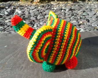 Bob Elephant, amigurumi crochet soft toy suitable from birth, red gold and green.