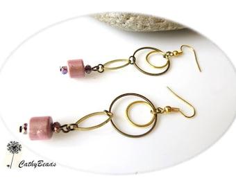 Earrings in two colors of metal rings