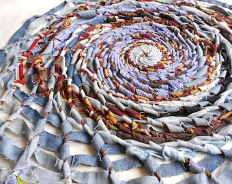 Hand woven rug with recycled fabrics