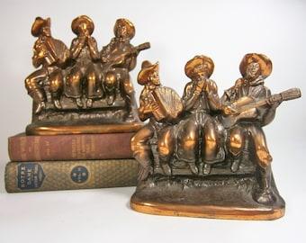 Westlichen Buchstützen, hergestellt von Ray E Dodge Co. in den 1940er Jahren, drei Cowboys singen, spielen Instrumente, Bronze Buchstützen, Dodge Buchstützen