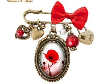 PIN * pretty poppy * bronze glass cabochon flower