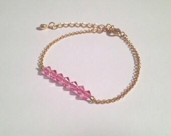Bracelet doré chaîne mailles jaseron fines et cristaux Swarovski roses