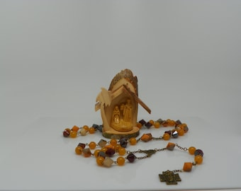 Rosary made with bronze medals, yellow jade beads and bicone acrilic beads(.)