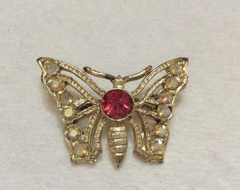 Vintage rhinestone gold colored metal butterfly brooch.