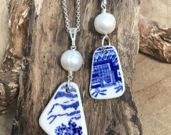 Blue and white Scottish Sea Pottery with an oversized freshwater pearl with sterling silver .