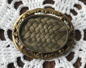 Antique mourning brooch with hair