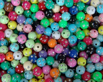 Multicolor bag of 50 acrylic beads with rhinestone encrusted