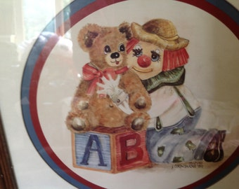 clown and teddy bear print by Casey framed and matted