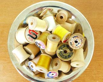 Twenty three vintage wooden spools
