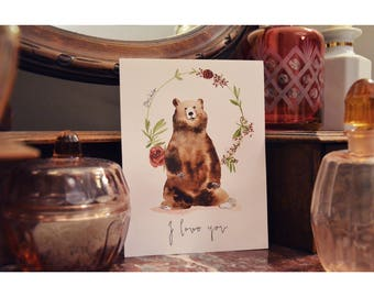 Card watercolor brown bear and flower wreath