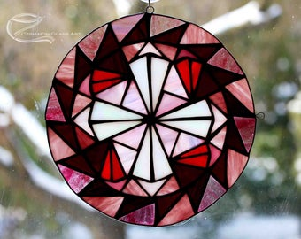 Mandala, tiffany glass  everething is in the moving around one point. The middle point is the peace. Meditation mandala