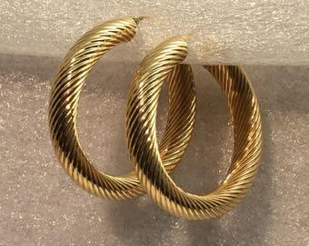 Vintage Large Bold 14kt yellow gold hoop earrings.
