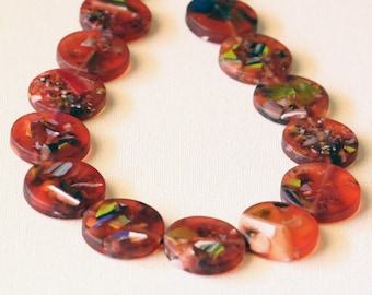 Statement necklace, featuring large round red resin beads.