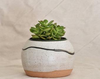 Wheel thrown speckled stoneware planter with brush stroke