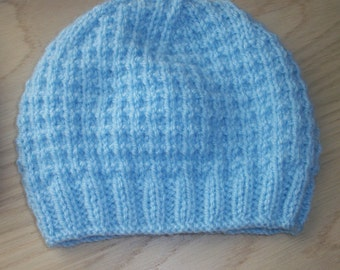 Hand knit baby hat. Double knit yarn. To fit from 0-3 months.