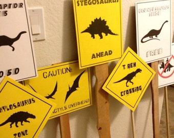 PDF: Set of 7 Dinosaur Crossing Signs - Dinosaur Themed Party Warning Caution Zone Paleo Caveman silhouette