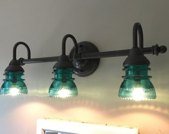 3 Light Bathroom Vanity Fixture With Clear Vintage Glass Insulators With An  Oil Rubbed