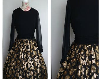 vintage 1950s Parade of New York black and gold party dress with leaf pattern