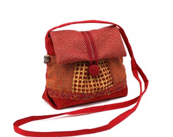 Small bag fabric shoulder clutch original flap, red tones with orange and yellow ochre.