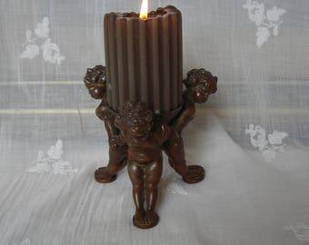 Unique bronze candleholder.  Old 'cherubs' candleholder.