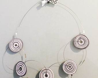 Necklace. Coloured handmade paper and steel jewel unique piece. It's composed by 5 circles made by quilling technique. Colors: grey, white.