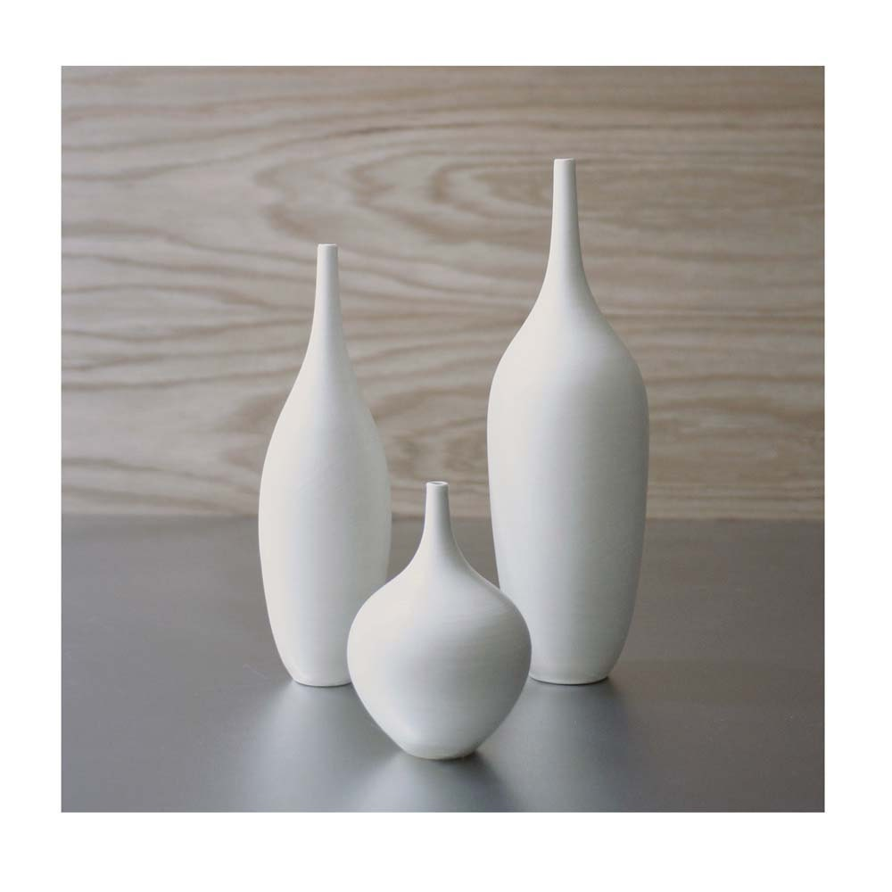Trio of pure white ceramic bottle vases in modern matte white description sarapaloma ceramics pottery vase white reviewsmspy