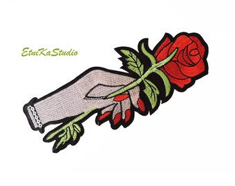 Hand holding red rose Iron-On applique patch, large embellishment