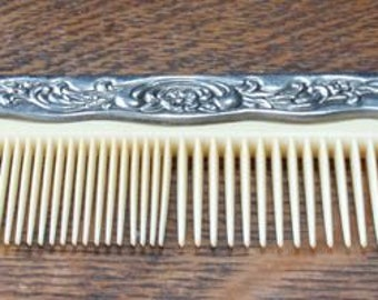 Silver handle victorian celluloid comb