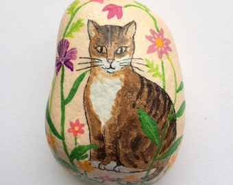 Tabby cat in a garden painted rock paperweight