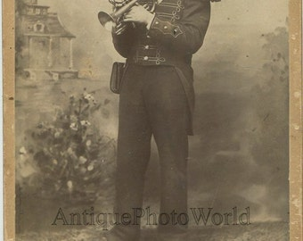 Soldier in uniform with trumpet antique cabinet photo