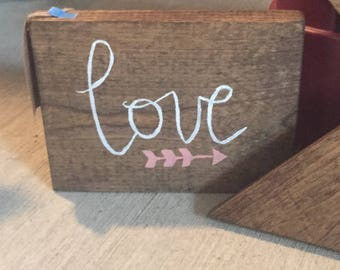 Love sign with coral arrow