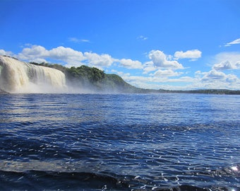 Waterfall amongst deep blue waters