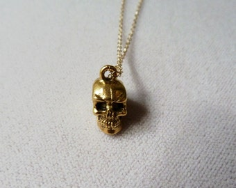Gold skull necklace