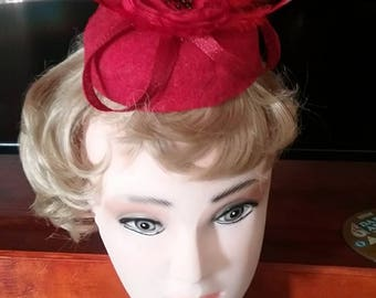Small red felt pillbox style hat