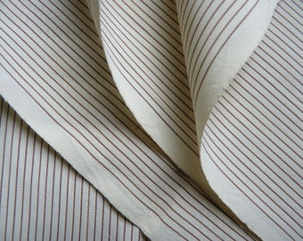 embroidery light beige stripes on ivory background, use for lining, 75 cm x 150 cm.