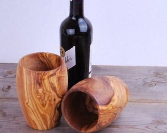 A pair of goblets made with olive wood