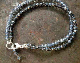 Crystal bracelet in shades of grey and palest blue with 925 silver closure.