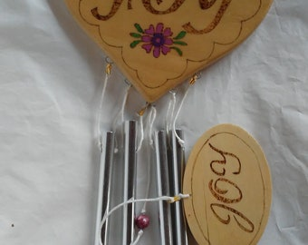 Heart shaped wind chimes wood burned plaque with Joy and flowers, painted and sealed, striker has small wooden Joy wind catcher.