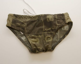"FOREST GREEN . child swim trunks . bathing suit . child size 3 / 20"" waist"