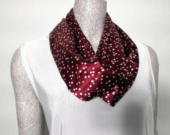 Maroon/Burguindy polka dot ladies infinity scarf.  Medium body/weight silky feeling fabric drapes nicely.