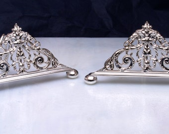 Twinned solid silver menu holders